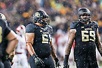 Baylor Bears offensive lineman Pat Colbert (69) and Baylor Bears offensive lineman Jarell Broxton (61) in action during the game between the Oklahoma Sooners and the Baylor Bears at the McLane Stadium in Waco, Texas. OU defeats Baylor 44 to 34.
