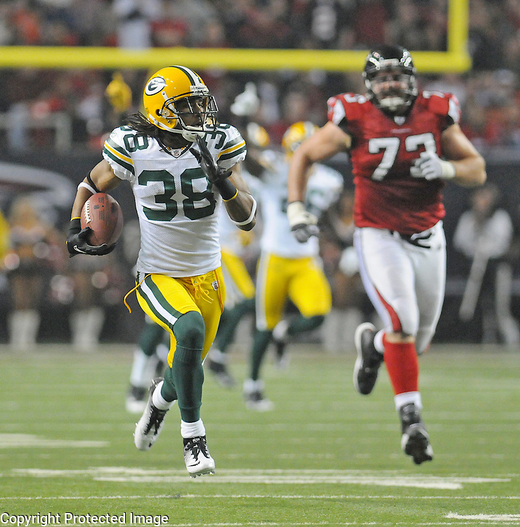 Green Bay Packers cornerback Tramon Williams returns an interception for a touchdown as guard Harvey Dahl pursues against the Atlanta Falcons during the second quarter of the Divisional round playoff game at the Georgia Dome in Atlanta, Ga., on Saturday, Jan. 15, 2011.