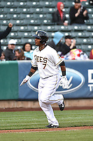 Luis Jimenez (7) of the Salt Lake Bees rounds the bases after hitting a home run against the Sacramento River Cats at Smith's Ballpark on April 3, 2014 in Salt Lake City, Utah.  (Stephen Smith/Four Seam Images)