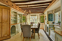 BNPS.co.uk (01202) 558833<br /> Pic: KnightFrank/BNPS<br /> <br /> Pictured: Dining room<br /> <br /> A historic English country estate with a French chateau feel and royal connections is on the market for £5.5m.<br /> <br /> The site of Grade II listed Yarner House was once governed by William the Conqueror, mentioned in the Domesday Book and a popular hunting site in Tudor times.<br /> <br /> The seven-bedroom house sits in a 247-acre estate on the edge of Dartmoor National Park and has stunning views over the surrounding landscape, including Yarner Wood.<br /> <br /> The ancient woodland was once part of the property until 1952 when it was sold to the Nature Conservancy to become one of the first national nature reserves.<br /> <br /> Where the current Yarner House is built, it is thought to have had a hunting lodge in Tudor times, with connections to Henry VII, Henry VIII, Edward VI and Queen Mary.