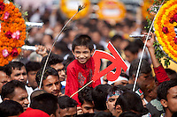 A Bangladeshi child sits on the shoulder of his father as they along with others stand in a queue to pay homage at the Dhaka Central Shaheed Minar, or Martyr's Monuments on International Mother Language Day in Dhaka, Bangladesh, Saterday, Feb. 21, 2015. International Mother Language Day is observed in commemoration of the movement where a number of students died in 1952, defending the recognition of Bangle as a state language of the former East Pakistan, now Bangladesh. The day is now observed across the world to promote linguistic and cultural diversity and multilingualism.