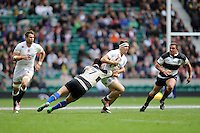 Alex Lewington of England is tackled by George Smith of Barbarians during the match between England and Barbarians at Twickenham Stadium on Sunday 31st May 2015 (Photo by Rob Munro)