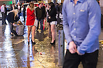 """© Joel Goodman - 07973 332324 . 20/12/2014 . Manchester , UK . A woman falls over on Withy Grove . """" Mad Friday """" revellers out in the rain and cold in Manchester . Mad Friday is typically the busiest day of the year for emergency services , taking place on the last Friday before Christmas when office Christmas parties and Christmas revellers enjoy a night out .  Photo credit : Joel Goodman"""
