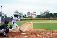 GCL Yankees East designated hitter Raymundo Moreno (13) swings at a pitch in front of GCL Yankees West catcher Carlos Narvaez during the first game of a doubleheader against the GCL Yankees West on July 19, 2017 at the Yankees Minor League Complex in Tampa, Florida.  GCL Yankees West defeated the GCL Yankees East 11-2.  (Mike Janes/Four Seam Images)