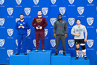 STANFORD, CA - March 7, 2020: Jarrod Snyder of Cal State Bakersfield, Tanner Hall of Arizona State University, David Showumi of Stanford, and Sam Aguilar of Cal Poly receive awards during the 2020 Pac-12 Wrestling Championships at Maples Pavilion.