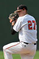 Starting pitcher Kevin Coulter (27) of the Mercer Bears pitches in a SoCon Tournament game against the Furman Paladins on Thursday, May 26, 2016, at Fluor Field at the West End in Greenville, South Carolina. Mercer won, 6-1 and Coulter pitched a complete game. (Tom Priddy/Four Seam Images)