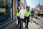 © Joel Goodman - 07973 332324 . 24/04/2011 . Brighton , UK . An antifascist counter protester is detained by police . Nationalist street movement March for England holds a march and rally in Brighton , opposed by antifascists . Photo credit : Joel Goodman
