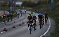 16 AUG 2014 - DARTFORD, GBR - Competitors race along a closed lane of Bob Dunn Way during the 2014 Midnight Wo/Man triathlon in Dartford, Great Britain (PHOTO COPYRIGHT © 2014 NIGEL FARROW, ALL RIGHTS RESERVED)