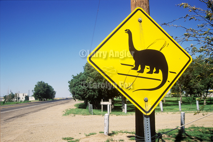 Dinosaur Crossing sign along the highway in Oklahoma Panhandle town of Boise City. Boise City is in a geological area known for dinosaur fossils.