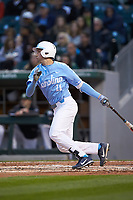 Cody Roberts (11) of the North Carolina Tar Heels follows through on his swing against the Charlotte 49ers at BB&T BallPark on March 27, 2018 in Charlotte, North Carolina. The Tar Heels defeated the 49ers 14-2. (Brian Westerholt/Four Seam Images)