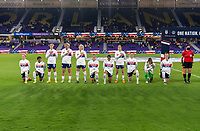 ORLANDO, FL - JANUARY 18: The USWNT stands and kneels before the national anthem during a game between Colombia and USWNT at Exploria Stadium on January 18, 2021 in Orlando, Florida.