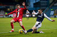 19th December 2020; Dens Park, Dundee, Scotland; Scottish Championship Football, Dundee FC versus Dunfermline; Dominic Thomas of Dunfermline Athletic challenges for the ball with Jordan Marshall of Dundee