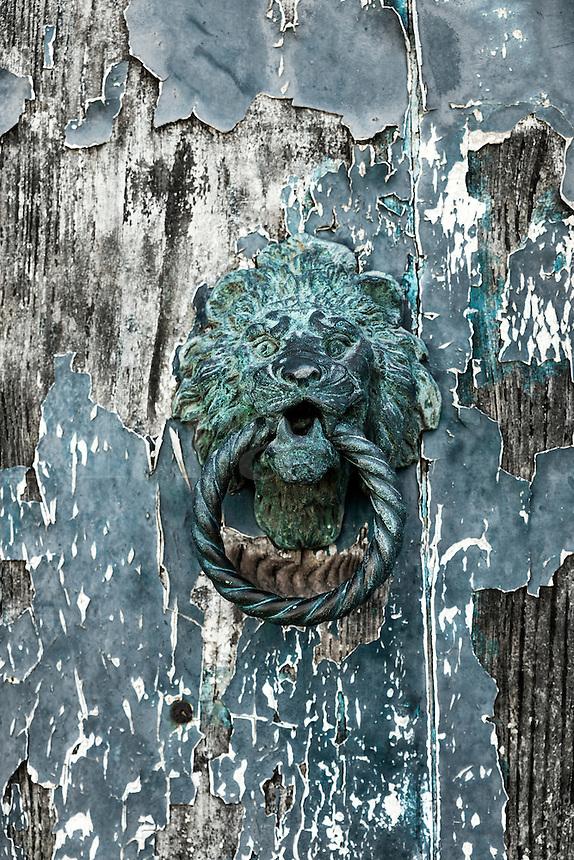 Rustic and worn door knock, Murano, Venice, Italy