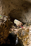 Two Figures make their way into the massive natural bridge called Tonto.