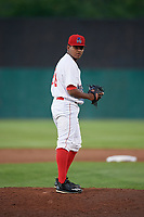Auburn Doubledays relief pitcher Yonathan Ramirez (26) gets ready to deliver a pitch during a game against the Connecticut Tigers on August 8, 2017 at Falcon Park in Auburn, New York.  Auburn defeated Connecticut 7-4.  (Mike Janes/Four Seam Images)
