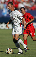 July 24, 2005: East Rutherford, NJ, USA:  USMNT forward Brad Davis (21) takes the ball into the box during the CONCACAF Gold Cup Finals at Giants Stadium.  The USMNT won 3-1 on penalty kicks.