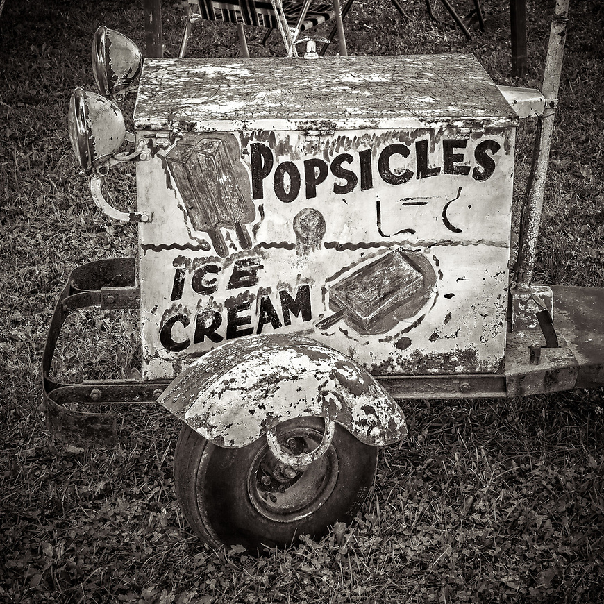 COOL MEMORIES -- Nothing beats the heat like a cold popsicle! This cart was found in Edgerton, Wisconsin, USA. #michaelknapstein #midwestmemoir #blackandwhite #B&W #monochrome #motherfstop #wisconsin  #bwphotography #myfeatureshoot  #fineartphotography #americanmidwest #squaremag #lensculture #mifa #moscowfotoawards #moscowinternationalfotoawards #rps #royalphotographicsociety #CriticalMass #CriticalMassTop200 #photolucida  #portfolioshowcase11 #thegalaawards #thepolluxawards #flakphoto #ipe160 #ipe161 #grainedephotographe  #galleryofwisconsinart