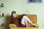 Portrait of woman relaxing on armchair