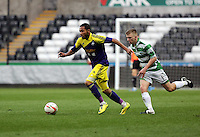 Thursday, 16 April 2014<br /> Pictured L-R: Kenji Gorre of Swansea is chased by Ryan Kershaw of TNS. <br /> Re: FAW Youth Cup Final, Swansea City FC v The New Saints FC at the Liberty Stadium, south Wales,