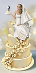 Illustrative image of bride sitting on a huge cake as she holds groom on a piece of cake