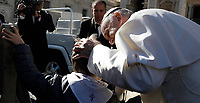 Papa Francesco accarezza un bambino al termine dell'udienza generale del mercoledi' in Piazza San Pietro, Citta' del Vaticano, 8 novembre, 2017.<br /> Pope Francis caresses a child  at the end of his weekly general audience in St. Peter's Square at the Vatican, on November 8, 2017.<br /> UPDATE IMAGES PRESS/IsabellaBonotto<br /> <br /> STRICTLY ONLY FOR EDITORIAL USE