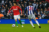 Saturday, 9 March 2013<br /> <br /> Pictured: Ki Sung-Yueng of Swansea City is challenged by Youssouf Mulumbu of West Bromwich Albion<br /> <br /> Re: Barclays Premier League West Bromich Albion v Swansea City FC  at the Hawthorns, Birmingham, West Midlands