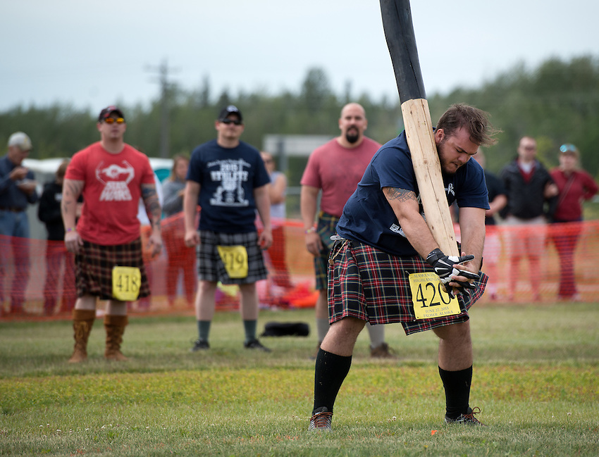 A competitor struggles to toss the caber during the 2015 Alaska Scottish Highland Games at the Palmer fairgrounds.