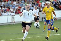 Amy Rodriguez #8, Sara Thunebro...USWNT tied Sweden 1-1 at Morison Stadium, Nebraska.
