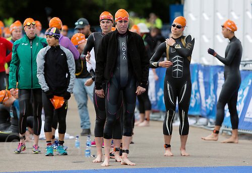31 MAY 2015 - LONDON, GBR - Gwen Jorgensen (USA) (centre) from the USA waits to be called onto the pontoon for the start of the elite women's 2015 ITU World Triathlon Series round in Hyde Park, London, Great Britain(PHOTO COPYRIGHT © 2015 NIGEL FARROW, ALL RIGHTS RESERVED)
