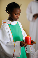 BURKINA FASO Dori, catholic church, holy mass, mass servant with candle / BURKINA FASO Dori, katholische Kirche, Gottesdienst, Messdienerin mit Kerze