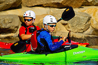Young outdoor enthusiasts learn the art of whitewater kayaking during a summer camp session at the US National Whitewater Center (USNWC) in Charlotte NC. The USNWC is home to one of the world's largest manmade recirculating whitewater courses. The two boys in this photo are model released.