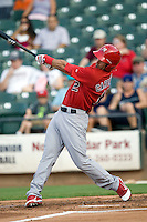 Memphis Redbirds third baseman Matt Carpenter #12 smashes a second inning home run during a game against the Round Rock Express at the Dell Diamond on July 7, 2011in Round Rock, Texas.  Round Rock defeated Memphis 6-4.  (Andrew Woolley / Four Seam Images)