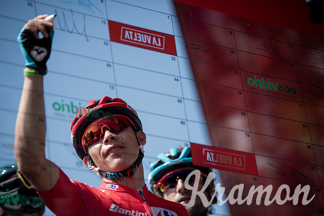 red jersey (overall leader) Miguel Angel 'Superman' Lopez (COL/Astana) at sign-on<br /> <br /> Stage 2: Benidorm to Calpe (199.6km)<br /> La Vuelta 2019<br /> <br /> ©kramon