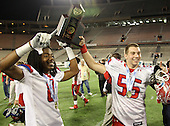 Manatee Hurricanes defensive back Willie Smith #8 and defensive lineman Blake Keller #55 hoist the Championship trophy after the Florida High School Athletic Association 7A Championship Game at Florida's Citrus Bowl on December 16, 2011 in Orlando, Florida.  Manatee defeated First Coast 40-0.  (Photo By Mike Janes Photography)