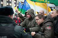 Moscow, Russia, 24/12/2011..Russian nationalists scuffle with security and police as they climb barriers in an attempt to get to the stage at anti-Kremlin protest. An estimated crowd of up to 100,000 protested against election fraud and Prime Minister Vladimir Putin in the largest anti-government demonstration in Russia since the collapse of the Soviet Union.