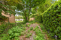 BNPS.co.uk (01202 558833)<br /> Pic: Homesestateagency/BNPS<br /> <br /> Pictured: An area of the garden.<br /> <br /> A timewarp home that has been lived in by the same family for more than a century has gone on sale for the first time since being built.<br /> <br /> At the time the property was built, King Edward VII was on the throne and the First World War had not even started.<br /> <br /> The property is being sold for £550,000 under probate by the original builder's three grandchildren, who were born in the Victorian-style house.<br /> <br /> The two-bedroomed home is in the Surrey town of Haslemere and belonged to the Berry family, who decided to sell after the death of their parents, Freda and Leslie.