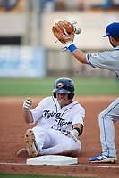 Lakeland Flying Tigers Brady Policelli (27) slides safely into third base as Blake Tiberi (24) catches the throw during a Florida State League game against the St. Lucie Mets on April 24, 2019 at Publix Field at Joker Marchant Stadium in Lakeland, Florida.  Lakeland defeated St. Lucie 10-4.  (Mike Janes/Four Seam Images)