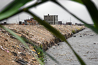Waste and garbage are seen on the banks of Río Chillón, a heavily contaminated river flowing through Ventanilla, a desert suburb of Lima, Peru, 24 January 2015. Although Latin America (as a whole) is blessed with an abundance of fresh water, having 20% of global water resources in the the Amazon Basin and the highest annual rainfall of any region in the world, an estimated 50-70 million Latin Americans (one-tenth of the continent's population) lack access to safe water and 100 million people have no access to any safe sanitation. Complicated geographical conditions (mainly on the Pacific coast), unregulated industrialization (causing environmental pollution) and massive urban poverty, combined with deep social inequality, have caused a severe water supply shortage in many Latin American regions.