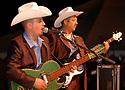 """voz-FoodCityFiestas0919 091407 Two members of the group """"Los Originales Cadetes de Linares"""" (cq) perform at the Food City Fiestas Patrias in Phoenix, on Friday, Sept. 14, 2007.  Photo by AJ Alexander/La Voz"""