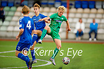 Kerry's Odhran Ferris keeps his eye on the ball despite the attention from Colm Lenihan and Jamie Doyle of Limerick in the EA Sports U17 League of Ireland soccer game