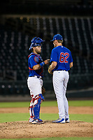 AZL Cubs catcher Richard Nunez (8) talks to relief pitcher Mitch Stophel (62) during a game against the AZL Padres 2 on August 28, 2017 at Sloan Park in Mesa, Arizona. AZL Cubs defeated the AZL Padres 2 9-4. (Zachary Lucy/Four Seam Images)