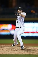 Charlotte Knights relief pitcher Connor Walsh (4) in action against the Scranton/Wilkes-Barre RailRiders at BB&T BallPark on August 14, 2019 in Charlotte, North Carolina. The Knights defeated the RailRiders 13-12 in ten innings. (Brian Westerholt/Four Seam Images)