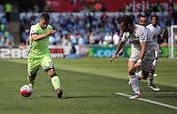 ( L-R ) Sergio Aguero of Manchester City against Jordi Amat of Swansea City during the Swansea City FC v Manchester City Premier League game at the Liberty Stadium, Swansea, Wales, UK, Sunday 15 May 2016