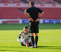 9th January 2021; City Ground, Nottinghamshire, Midlands, England; English FA Cup Football, Nottingham Forest versus Cardiff City; Harry Wilson of Cardiff City sits on the grass from an injury watched by Referee David Webb