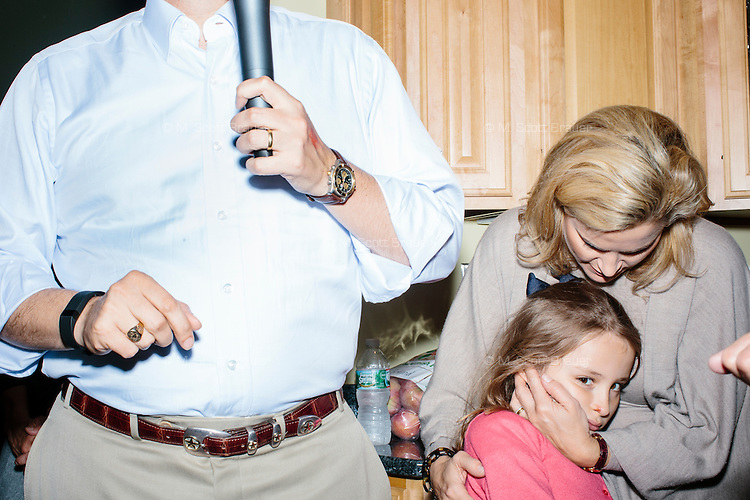 """Heidi Nelson Cruz, wife, and daughter, Caroline, stand by while Texas senator and Republican presidential candidate Ted Cruz speaks at an event called """"Smoke a cigar with Ted Cruz"""" at a house party at the home of Linda & Steven Goddu Salem, New Hampshire."""