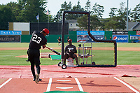 Batavia Muckdogs Brayan Hernandez (23) in a hitting drill with coach Rigoberto Silverio (sitting) during practice on June 12, 2019 at Dwyer Stadium in Batavia, New York.  (Mike Janes/Four Seam Images)