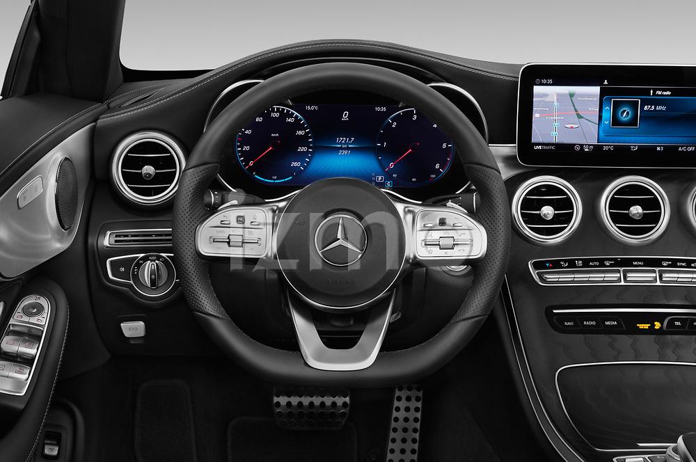 Car pictures of steering wheel view of a 2019 Mercedes Benz C-Class AMG-Line 2 Door Convertible Steering Wheel