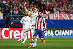 Atletico de Madrid's Arda Turan (R) and Real Madrid´s Toni Kroos during quarterfinal first leg Champions League soccer match at Vicente Calderon stadium in Madrid, Spain. April 14, 2015. (ALTERPHOTOS/Victor Blanco)