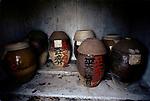 Cremation Chinese urns ancient traditional family burial ceramic jars. Man Mo Temple or called Man Mo Miu Temple storage Hong Kong 1990s 1991 China.