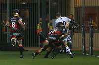 Dan Bigger of Ospreys runs for the corner as he is tackled by Ashton Hewitt and Carl Meyer of Dragons during the Guinness Pro 14 match between Newport Gwent Dragons and Ospreys at the Rodney Parade in Newport, Wales, UK. Sunday 31 December 2017